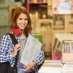 Smiling girl holding some vinyls — Stock Photo #56907271