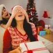 Mother surprising her daughter with christmas gift — Stock Photo #56907885