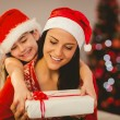 Festive mother and daughter smiling at camera — Stock Photo #56908491