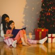 Mother and daughter waiting for santa claus — Stockfoto #56908821
