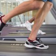 Fit man and woman running on treadmill — Stock Photo #56908833