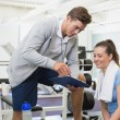 Personal trainer and client looking at clipboard together — Stock Photo #56908965