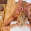 Woman receiving back massage — Stock Photo #56909025