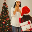 Daughter surprising her mother with christmas gift — Stock Photo #56909563