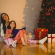 Mother and daughter waiting for santa claus — Stockfoto #56909591
