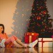 Mother and daughter waiting for santa claus — Stockfoto #56909653