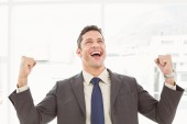 Cheerful businessman cheering in office — Stock Photo
