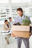 Businessman carrying his belongings in box — Stock Photo