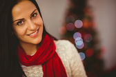 Pretty brunette relaxing at christmas — Stock Photo