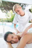 Woman receiving back massage at spa center — Stock Photo