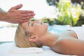 Attractive woman receiving head massage — Stock Photo