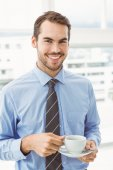 Smiling businessman during break time in office — Stock Photo