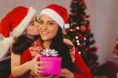 Daughter giving her mother a christmas present — Stock Photo