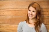 Pretty redhead smiling and thinking — Fotografia Stock