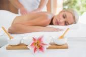 Woman receiving back massage — Stock Photo