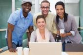 Colleagues using laptop at office — Stock Photo
