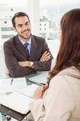 Businessman interviewing woman in office — Stok fotoğraf