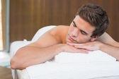 Man lying on massage table — Stock Photo