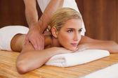 Woman receiving shoulder massage — Stock Photo