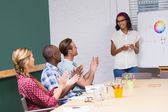 Casual business people clapping hands in meeting — Stock Photo