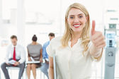 Businesswoman gesturing thumbs up — Stock Photo