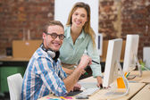 Casual female photo editor using digitizer in office — Stock Photo