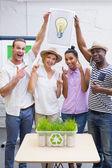 Creative business team holding Idea light bulb in meeting — Stock Photo