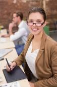 Female photo editor using digitizer in office — Stock Photo