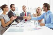 Business people clapping hands in board room meeting — Stock Photo