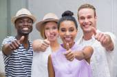 Creative colleagues gesturing thumbs up — Stock Photo