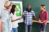 Creative colleagues with recycling symbol on whiteboard — Stock Photo