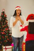 Daughter surprising her mother with christmas gift — Stock Photo