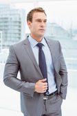 Smart businessman in suit at office — Stock Photo