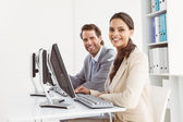 Business people using computers in office — Stock Photo