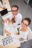 Concentrated casual photo editors at work in office — Stock Photo