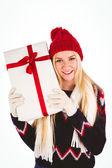 Festive blonde holding a gift — Stockfoto