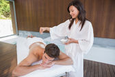 Man receiving treatment at spa center — Stock Photo