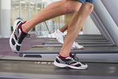 Fit man and woman running on treadmill  — Foto Stock