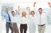 Business people cheering in office — Stock Photo