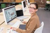 Businesswoman using computer at office desk — Stock Photo