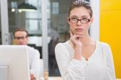 Serious female photo editor in office — Stock Photo