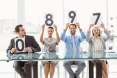 Interview panel holding score cards in office — Foto Stock