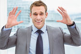 Angry young businessman at office — Stock Photo