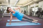 Fit brunette doing pilates on exercise mat — Stock Photo