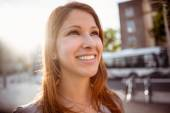 Smiling pretty redhead on a sunny day — Stock Photo