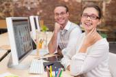 Smiling photo editors using computer in office — Stock Photo