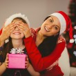 Mother surprising her daughter with christmas gift — Stock Photo #56910357
