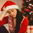 Festive brunette feeling sad at christmas — Stock Photo #56910849