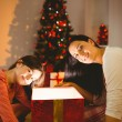Festive mother and daughter opening a glowing christmas gift — Stock Photo #56911099