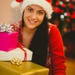 Festive brunette smiling at camera — Stock Photo #56911653